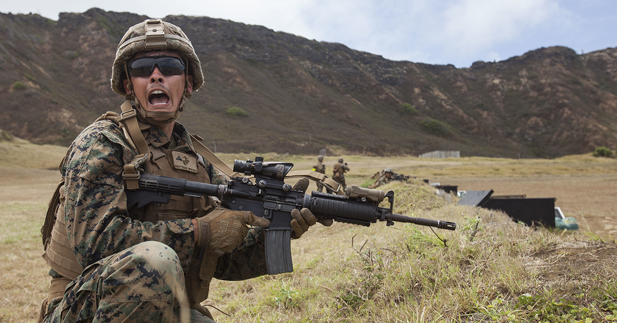 Marine Lance Cpl. Wyatt Prettyman, a squad leader with Lima Company, 3rd Battalion, 3rd Marine Regiment, III Marine Expeditionary Force, yells commands during a fire team assault at the Kaneohe Bay Range Training Facility, Marine Corps Base Hawaii, July 26, 2018. Marines with India, Kilo and Limo Company worked together to improve their communication, leadership and lethality as a fire team. (Sgt. Jesus Sepulveda Torres/Marines)