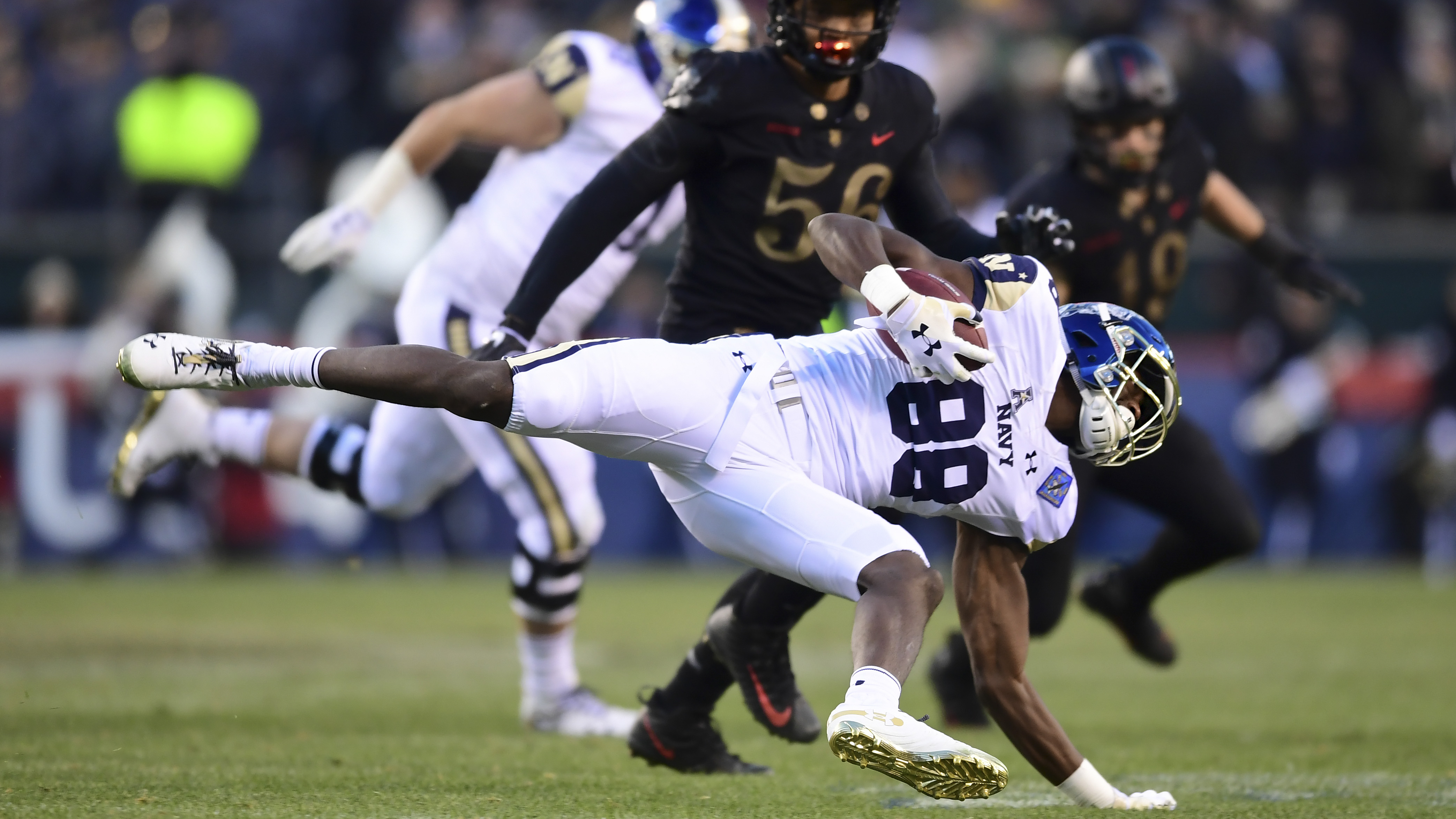 Mychal Cooper #88 of the Navy Midshipmen carries the ball during the first quarter of the game against Army Black Knights at Lincoln Financial Field on December 08, 2018 in Philadelphia, Pennsylvania. (Photo by Sarah Stier/Getty Images)