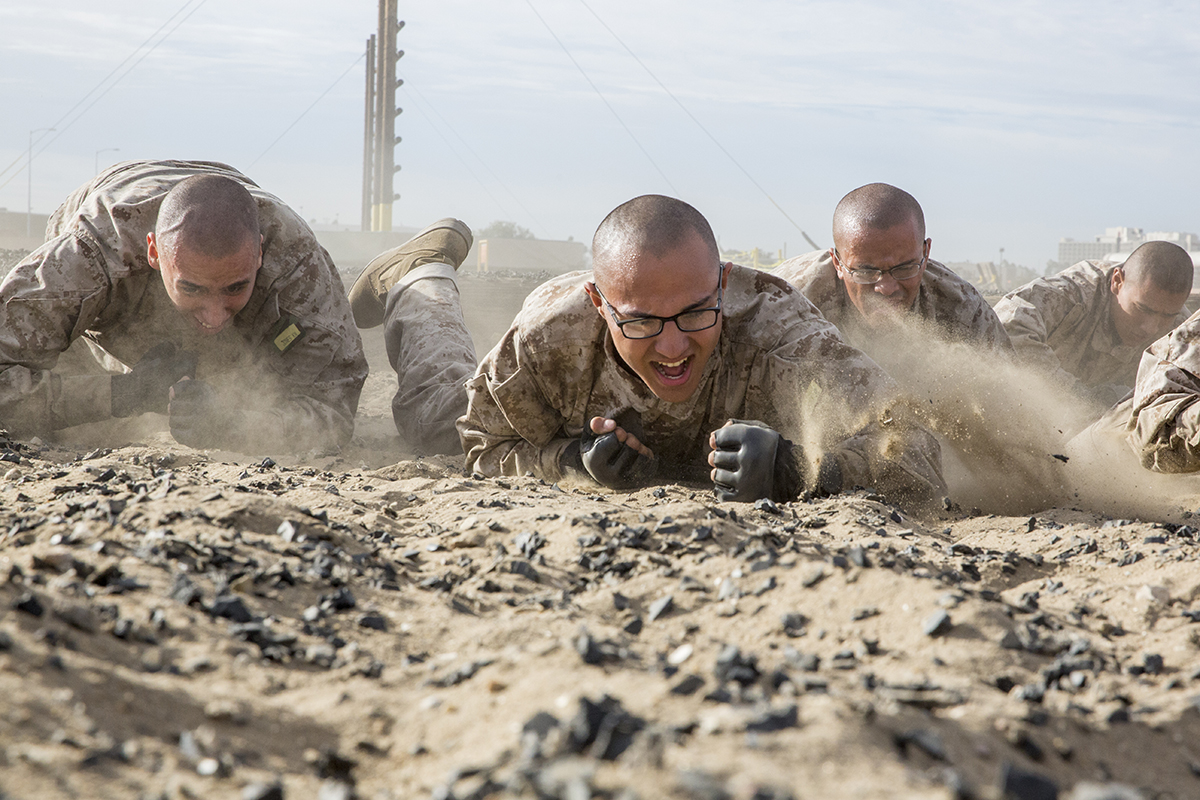 Recruits with Hotel Company, 2nd Recruit Training Battalion, crawl during a combat conditioning exercise at Marine Corps Recruit Depot San Diego on Nov. 14, 2018. (Marine Corps)