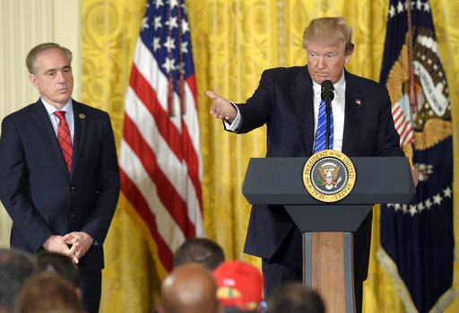 President Donald Trump, right, stands with Veterans Affairs Secretary David Shulkin, left, during a bill signing event on June 23, 2017. White House officials have declined to give a strong endorsement of Shulkin's job performance in recent days.(Susan Walsh/AP)