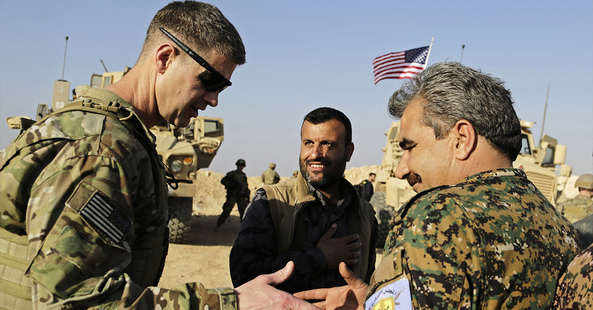 U.S. Army Maj. Gen. Jamie Jarrord, left, thanks Manbij Military Council commander Muhammed Abu Adeel during a visit to a small outpost near the town of Manbij, northern Syria, Wednesday, Feb. 7, 2018. Lt. Gen. Paul E. Funk, the top U.S. general in the coalition fighting the Islamic State group pledged American troops would remain in the town despite Ankara's demands for a U.S. pullout. (Susannah George/AP)