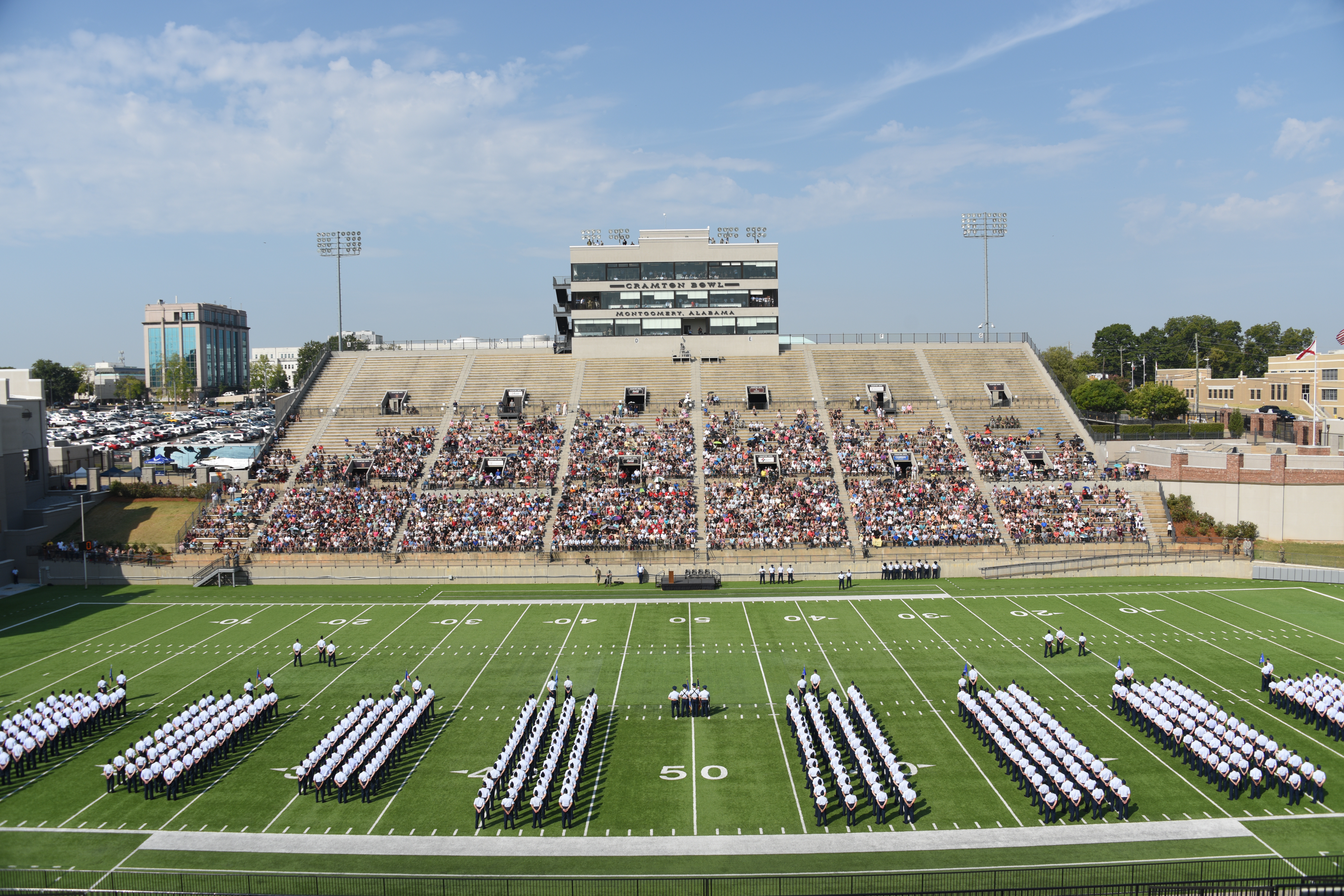 """The Air Force's newest commissioned officers from the Officer Training School class 19-07 form up on the Cramton Bowl football field Sept. 27, 2019, Montgomery, Alabama.Officer Training School's class 19-07, also known as """"Godzilla Class,"""" was comprised of 800 officer trainees and warranted a graduation venue off-base. (Staff Sgt. Quay Drawdy/Air Force)"""
