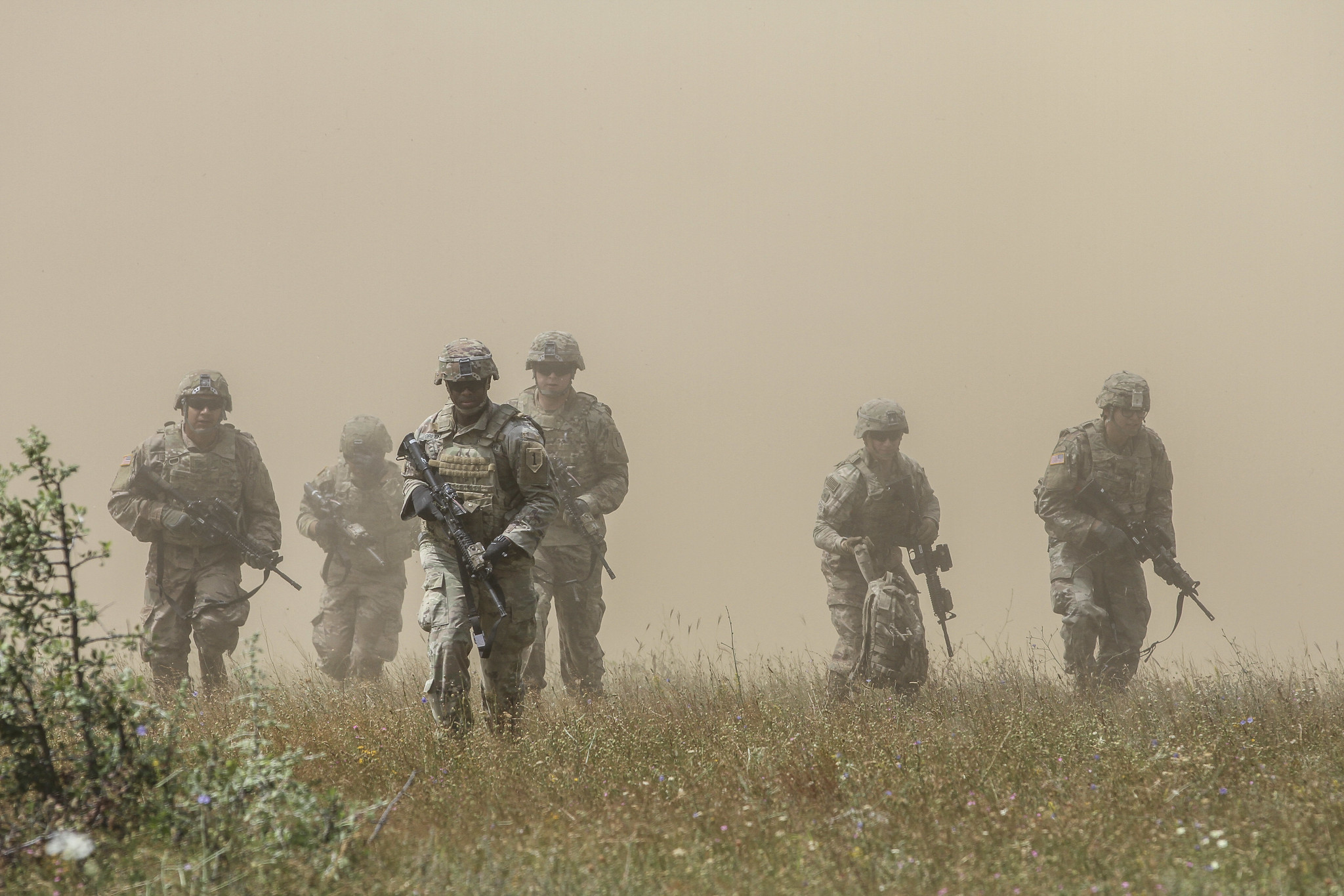 Cavalry scouts maneuver toward cover after an air assault during Platinum Lion 19 at Novo Selo Training Area in Bulgaria on July 9, 2019. (Staff Sgt. True Thao/Army)