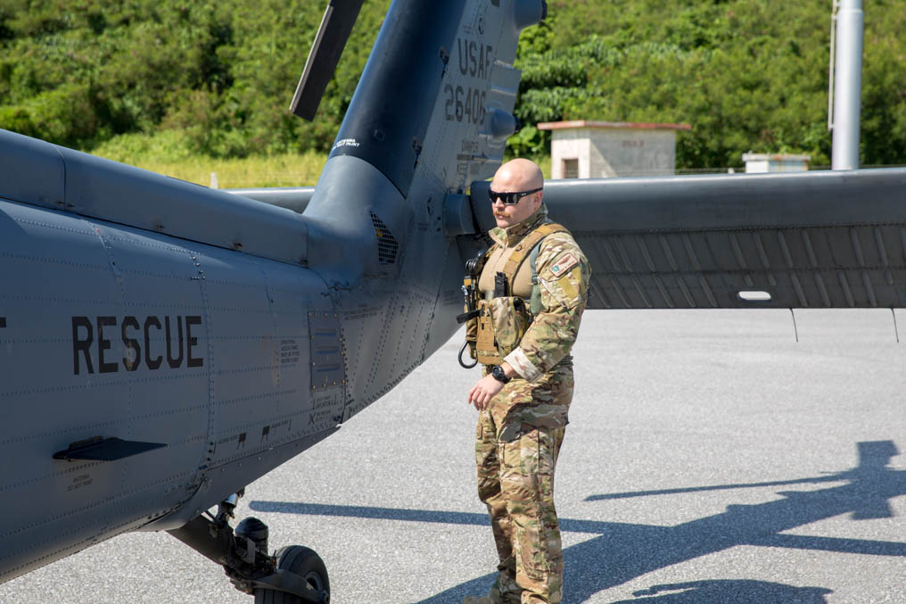 A pilot from the 33rd Rescue Squadron performs a preflight inspection of his HH-60G on Kadena Air Base. (Jeff Martin/Staff)