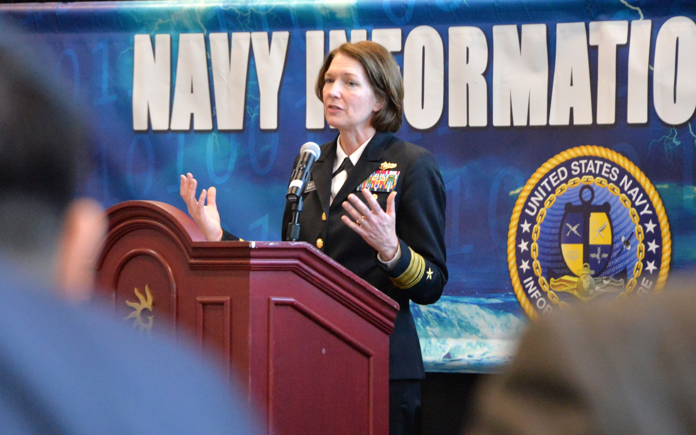 170403-N-UN340-004 National Harbor, Md. (Apr. 3, 2017) Rear Adm. Nancy Norton, formerly Director of Warfare Integration for Information Warfare (OPNAV N2N6F) /Deputy Director, provides a Navy cybersecurity information warfare update from her OPNAV Perspective in the Navy Information Warfare Pavilion at the 2017 Sea, Air and Space (SAS) exposition. The Information warfare pavilion is presented by a partnership between the Office of the Deputy Chief of Naval Operations for Information Warfare (OPNAV N2N6); Commander, U.S. Fleet Cyber Command/Commander, U.S. 10th Fleet (CFCC/C10F); Space and Naval Warfare Systems Command (SPAWAR) and Commander, Naval Information Forces (NAVIFOR), all key players in the Navy's Information Warfare community. SAS, sponsored by the U.S. Navy League, is the world's largest maritime exposition and provides a venue of interaction between the maritime defense industry and U.S and international military organizations. (U.S. Navy photo by Rick Naystatt/Released)