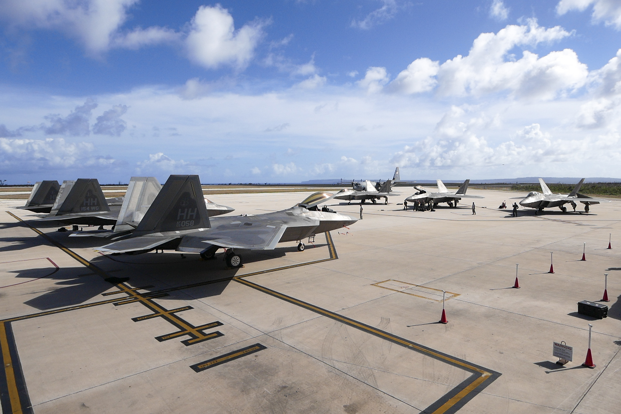 F-22 Raptors park during their inaugural appearance during exercise Resilient Typhoon, at the Francisco C. Ada International Airport, Saipan, April 23, 2019. (Senior Airman John Linzmeier/Air Force)