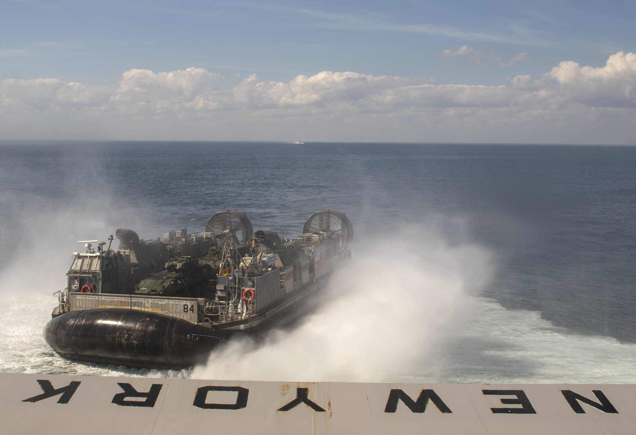 A landing craft, air cushion assigned to Assault Craft Unit (ACU) 4 leaves the well deck of the San Antonio-class amphibious transport dock ship USS New York (LPD 21), Oct. 3, 2018. New York departs Mayport, Fla., to participate in Trident Juncture 2018, a NATO-led exercise designed to certify NATO response forces and develop interoperability among participating NATO and partner nations. (MC2 Lyle Wilkie/Navy)
