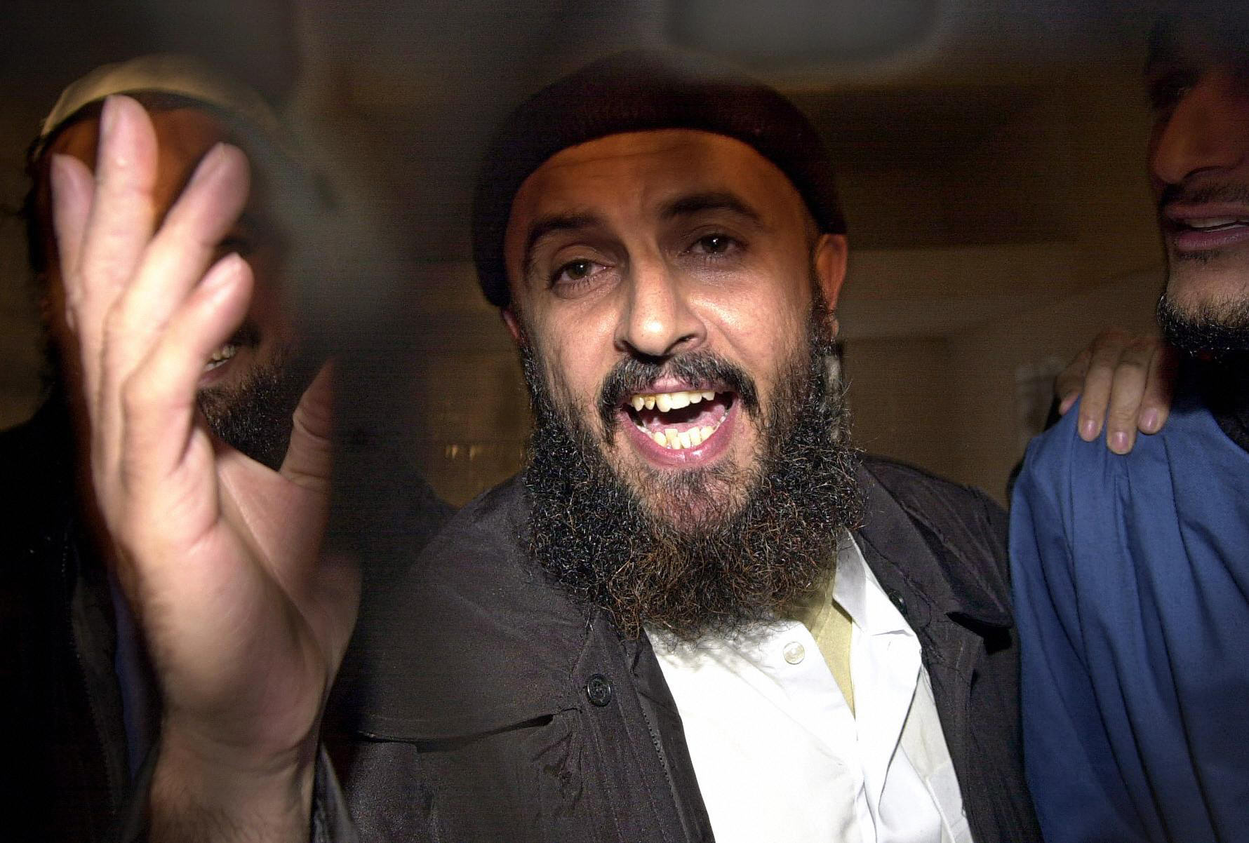 Jamal al-Badawi, one of the terrorist behind the bombing of the USS Cole destroyer's bombing in 2000 in the Yemeni port of Aden, was killed Tuesday in an airstrike. Here al-Badawi gestures after an appeal court announced his judgement to 15 years in prison on 26 February 2005. He later escaped from prison in 2006. (PKHALED FAZAA/AFP/Getty Images)