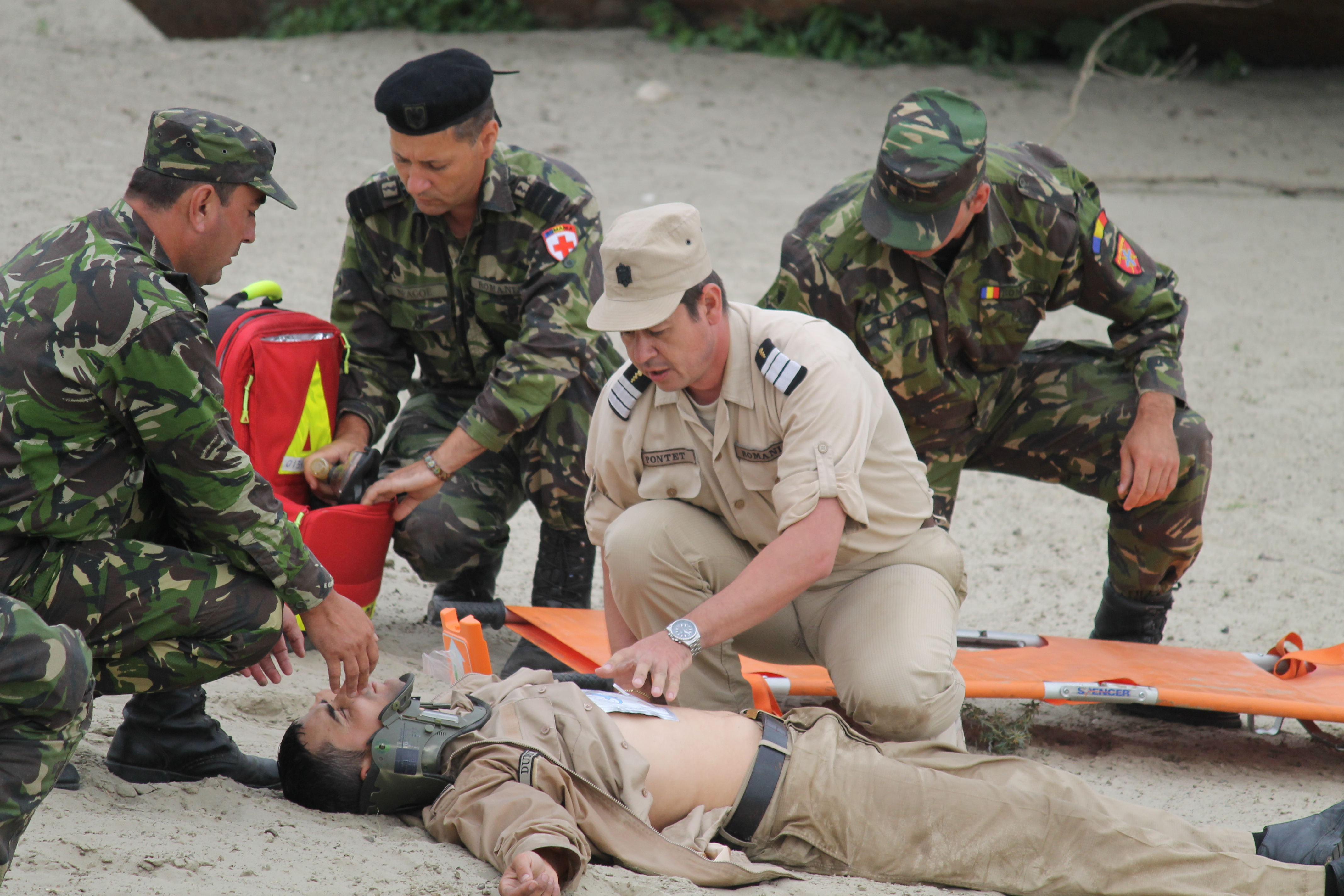 Romanian medics practice responding to an injured sailor from one of the navy ships in the river. A raft rescued the sailor, simulating an injury and brought him to shore, where he was treated and whisked away in a medical vehicle. The river crossing exercise also simulated a mass casualty event and corresponded with a mass casualty exercise at nearby Mihail Kogalniceanu Air Base, where the personnel feigned injuries to allow military medics from Romania, the U.S. and the Balkan Medical Task Force to practice high-level triage skills. (Jen Judson/Staff)