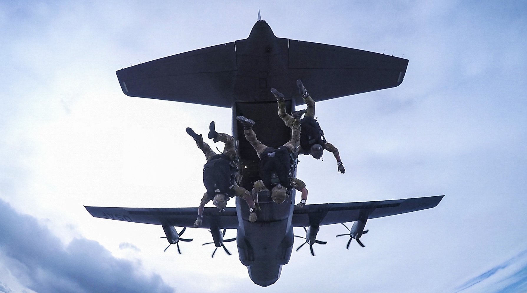 A U.S. Air Force Guardian Angel Team, consisting of pararescuemen, combat rescue officers and survival, evasion, resistance and escape specialists, assigned to the 83rd Expeditionary Rescue Squadron, Bagram Airfield, Afghanistan, conduct a high altitude, low opening military free fall jump working with a C-130J Super Hercules flown by the 774th Expeditionary Airlift Squadron, Bagram Airfield, Afghanistan, March 23, 2018. (Tech. Sgt. Gregory Brook/Air Force)