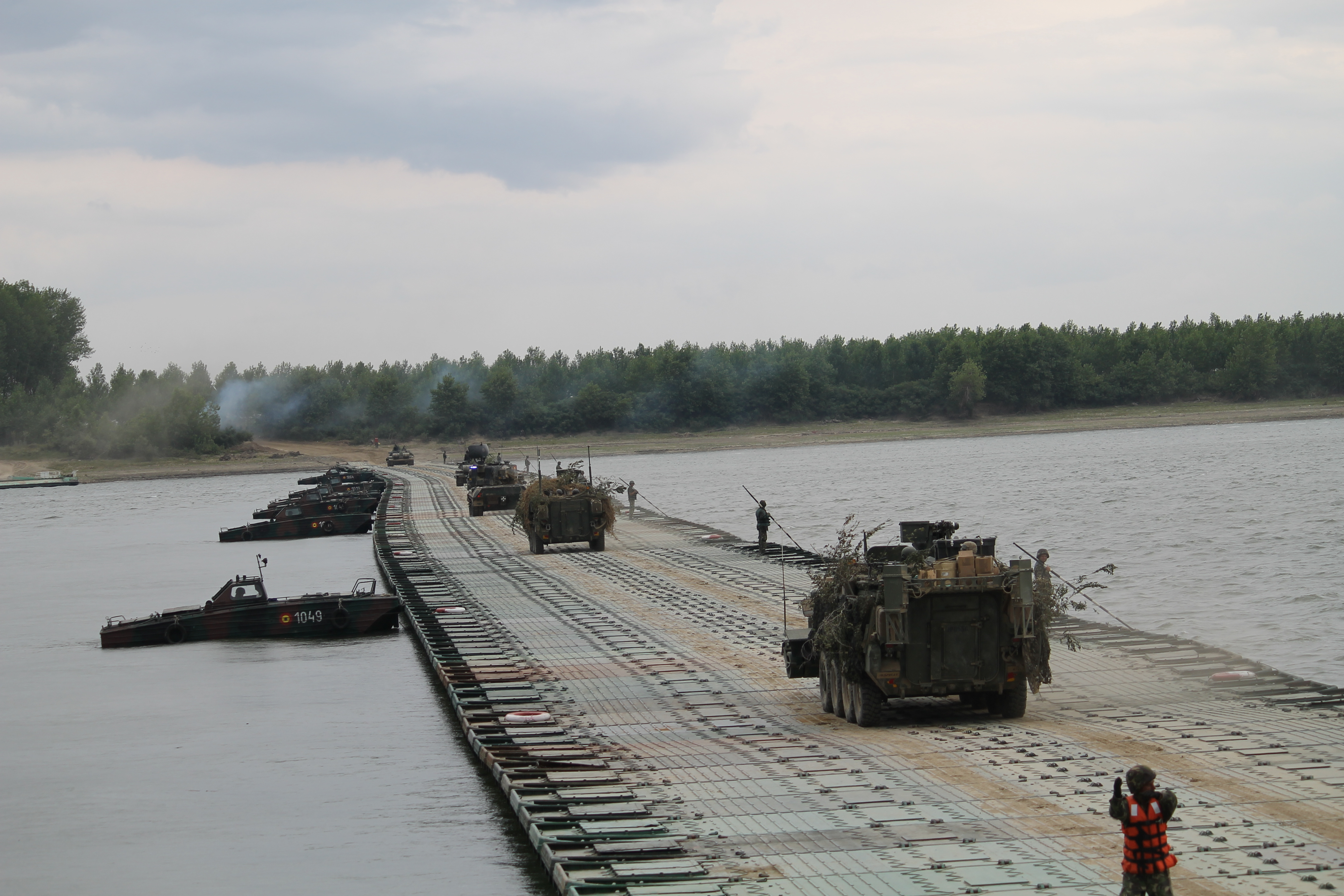 U.S. Strykers move slowly across the bridge to mark the end of the river crossing exercise. The U.S. Strykers of the 2nd Cavalry Regiment are often the vehicles of choice during bridging and river crossing exercises in Europe. U.S. Strykers crossed a bridge constructed using M3 amphibious vehicles In Chelmno, Poland, during the country's major military exercise Anakonda 2016 in June, for example. (Jen Judson/Staff)