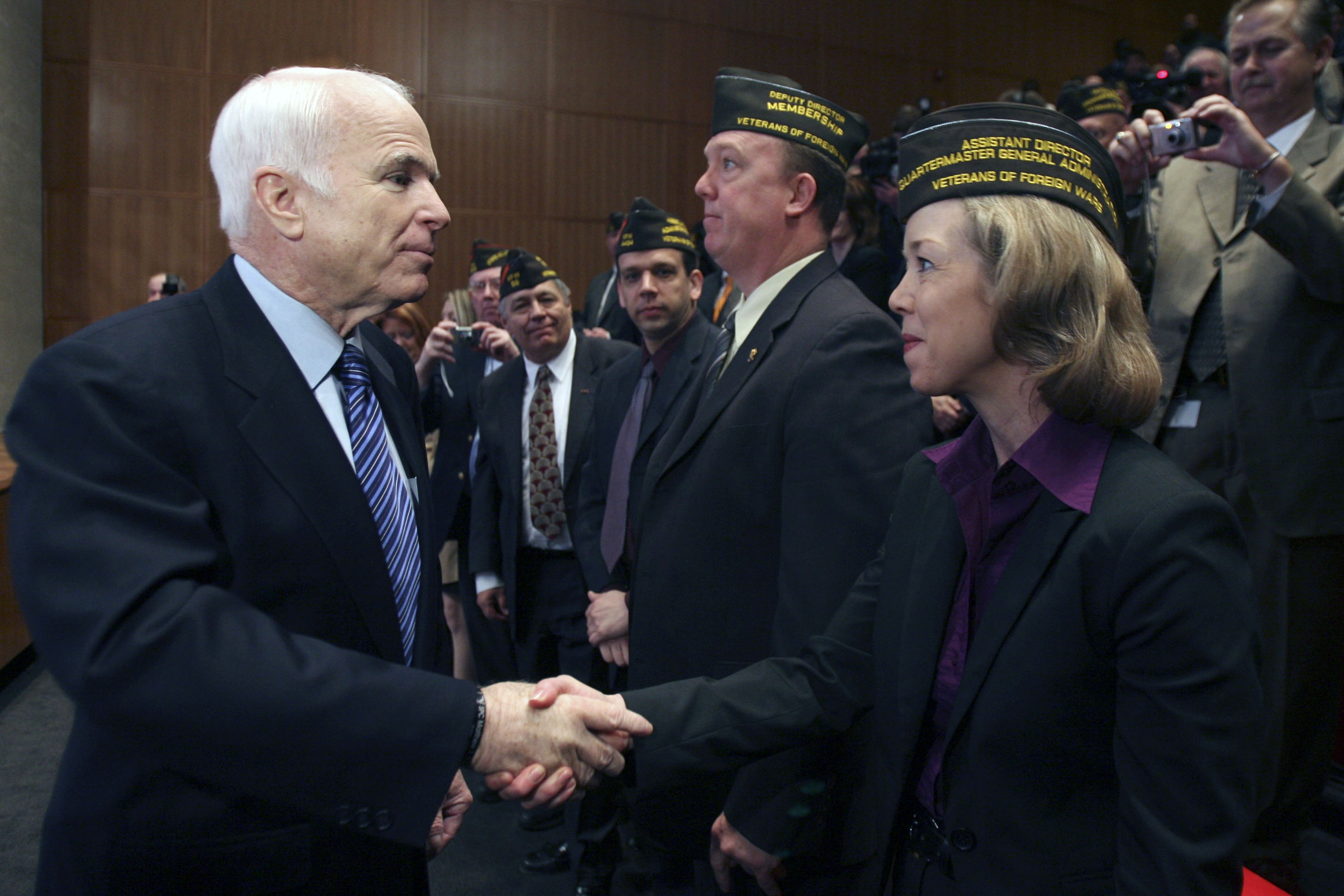 Sen. John McCain, R-Ariz., left, greets veterans who were in the audience after delivering a speech at the National World War I Museum on April 7, 2008, in Kansas City, Mo. (Mary Altaffer/AP)