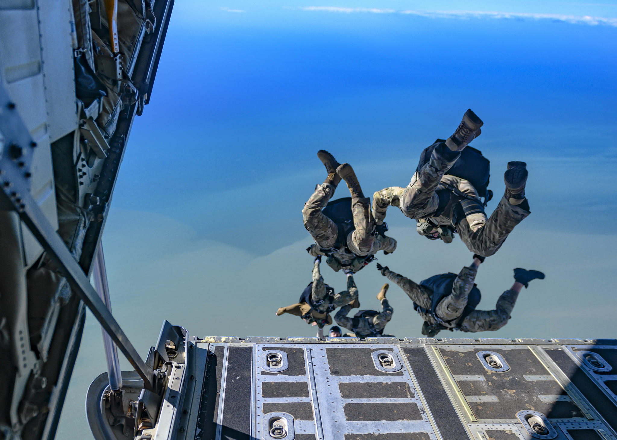 Explosive ordnance disposal technicians assigned to Explosive Ordnance Disposal Mobile Unit (EODMU) 8 conduct military free-fall training in Rota, Spain, Nov. 6, 2019. (Mass Communication Specialist 1st Class Scott Bigley/Navy)