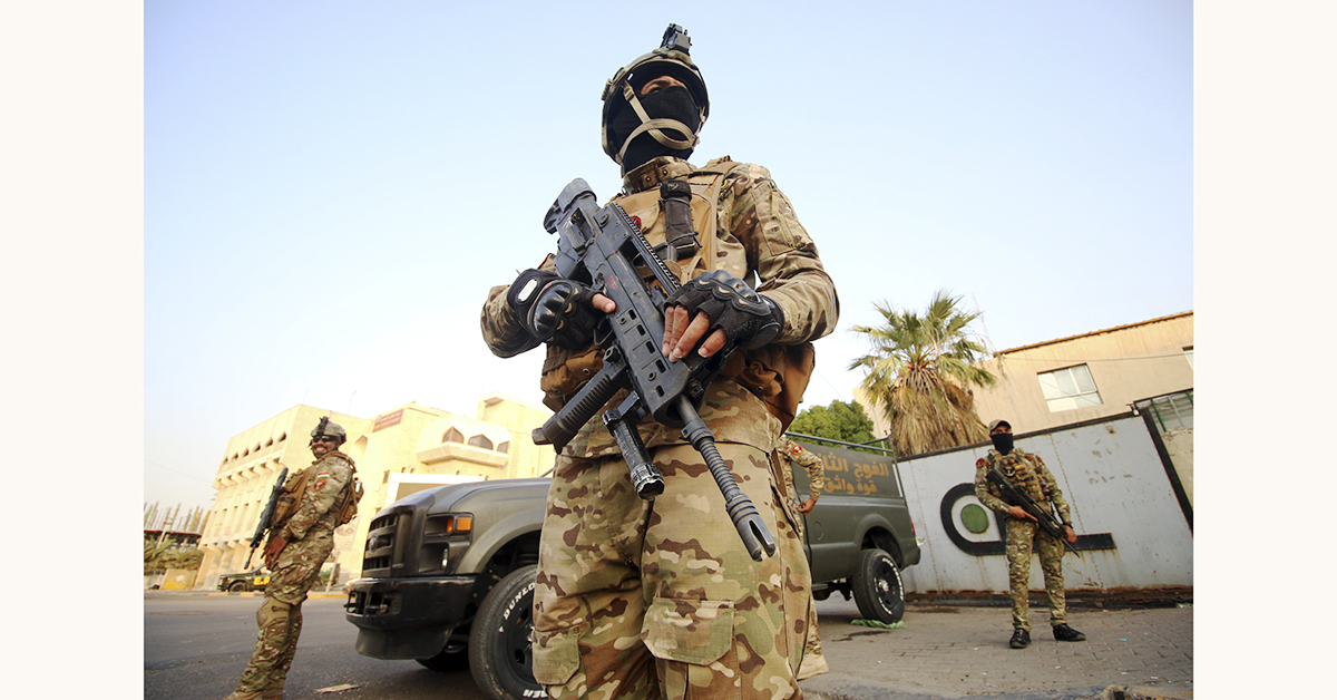 Iraqi special forces members patrol in a street in Basra on September 8, 2018, after Iraq's Joint Operations Command, which includes the army and police, vowed a