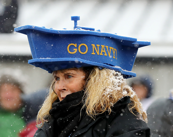A Navy fan watches the march-ons prior to Saturday's Army-Navy game at Lincoln Financial Field in Philadelphia. (Elsa/Getty Images)