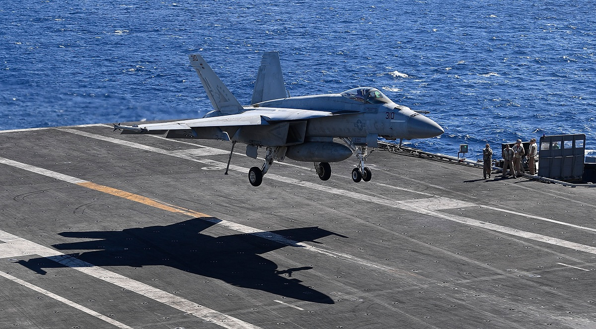 A U.S. Navy F/A-18 Super Hornet lands on the deck of the aircraft carrier Ronald Reagan. Switzerland may replace its decades-old fleet of the aircraft with new ones made by Boeing. (Ian Hitchcock/Getty Images)