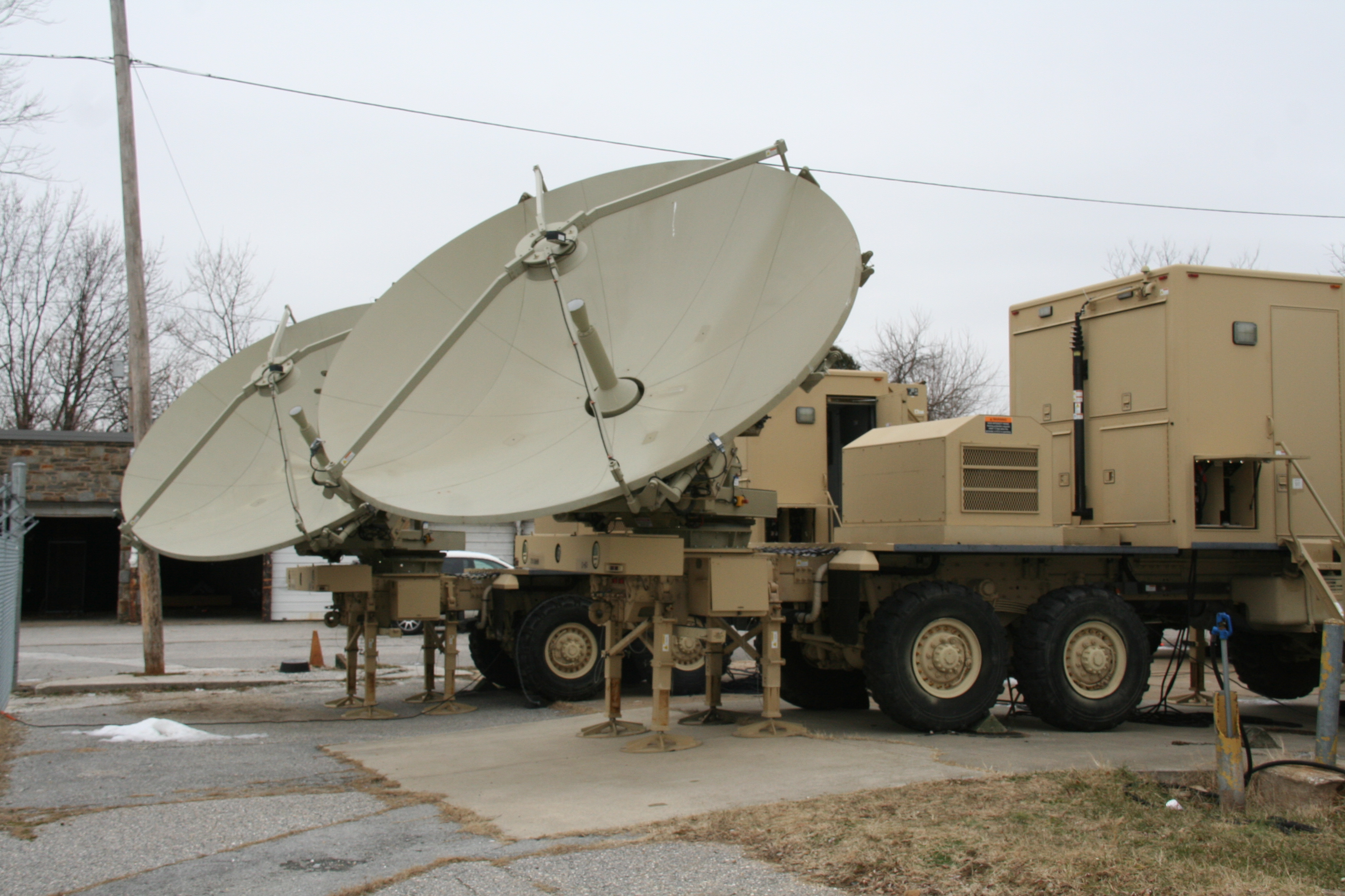 The National Guard's C Signal Company, 29th Infantry Division's training on Warfighter Information Network-Tactical (WIN-T) Increment 1 upgrades at Pikesville, Maryland on January 7, 2015 included training on these two WIN-T Unit Hub Satellite Communication Trucks. Amy Walker, PEO C3T/U.S. Army