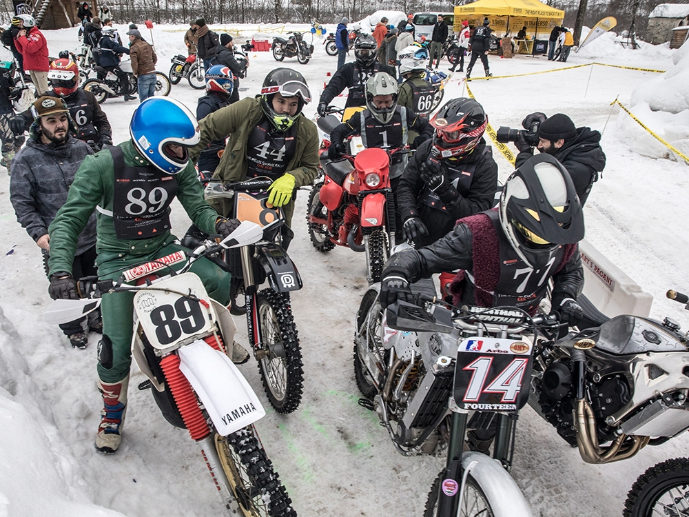 Riders in the pit getting ready to head out on timed solo runs through the icy track. (Monti Smith)