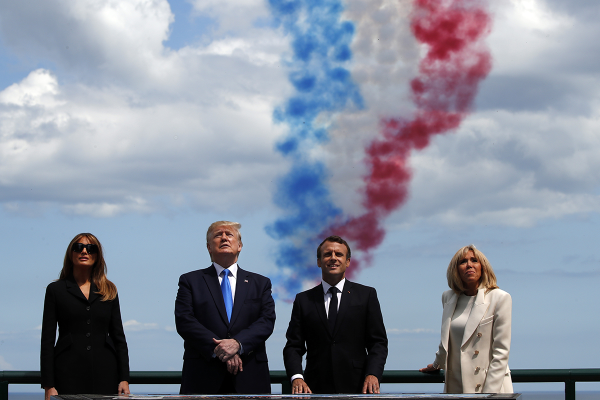 First lady Melania Trump, President Donald Trump, French President Emmanuel Macron and Brigitte Macron, watch a flyover during a ceremony to commemorate the 75th anniversary of D-Day at the American Normandy cemetery, Thursday, June 6, 2019, in Colleville-sur-Mer, Normandy, France. (Alex Brandon/AP)