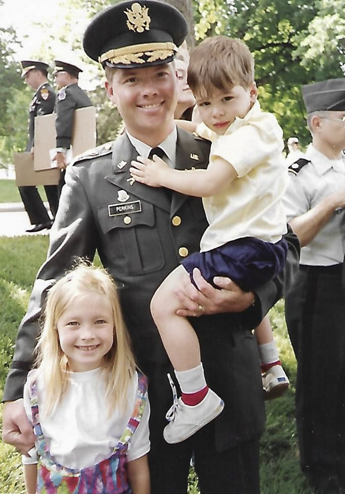 Maj. David Perkins with daughter, Cassandra, and son, Chad, following graduation from the Command and General Staff College in June 1992.