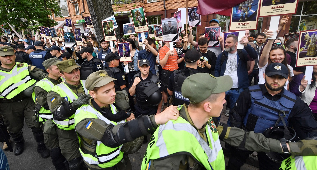 Policemen stand in front of protesters who demand to stop, as they say, pro-Russian actions, during the Immortal Regiment march marking Victory Day in Kiev on May 9, 2018. Some 35,000 people gathered in Ukraine's de facto rebel capital Donetsk to watch the parade. (Sergei Supinsky/AFP via Getty Images)