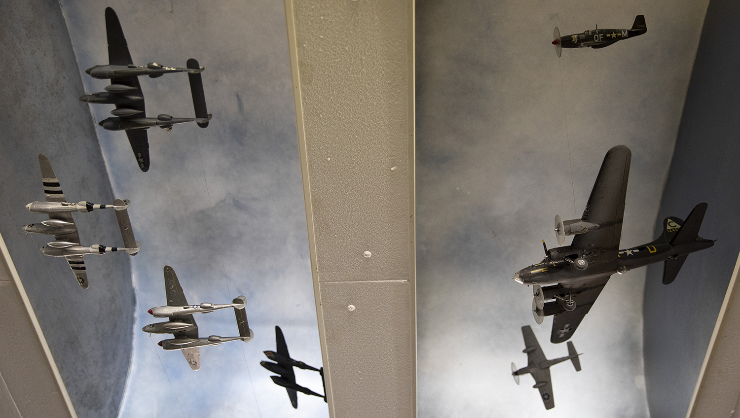 In this photo taken on Thursday, Nov. 7, 2019, a collection of World War II planes hang from the ceiling at the Remember Museum 39-45 in Thimister-Clermont, Belgium. (Virginia Mayo/AP)