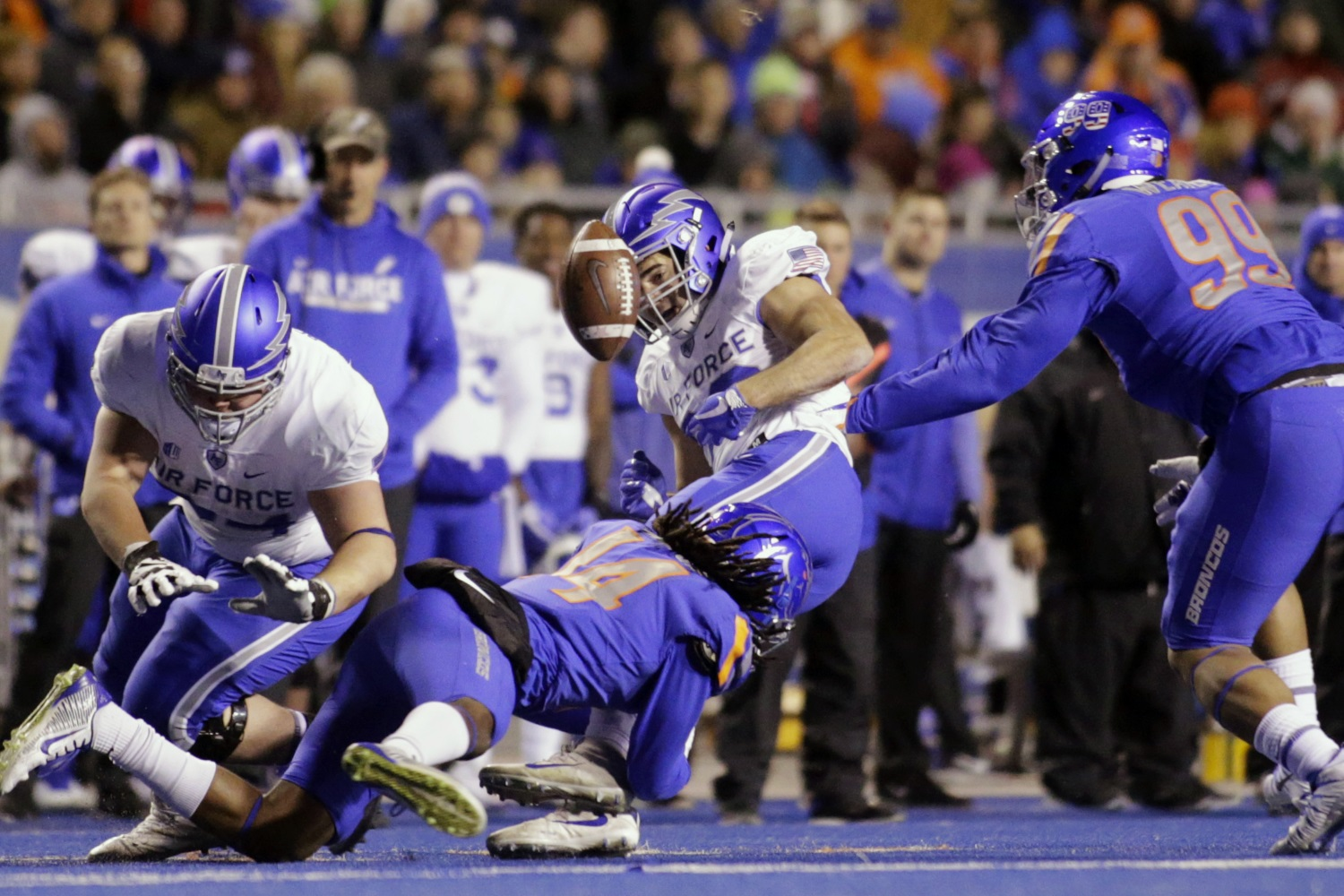 Air Force running back Tim McVey (33) fumbles the ball on a tackle by Boise State cornerback Tyler Horton (14) during the first half of an NCAA college football game in Boise, Idaho, Saturday, Nov. 18, 2017. (Otto Kitsinger/AP)