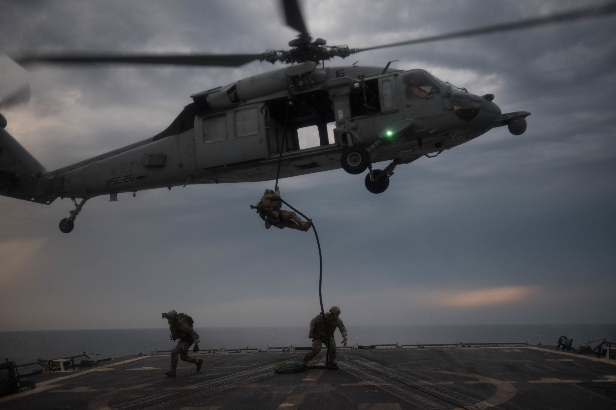 U.S. Coast Guard Maritime Security Reaction Team members rappel onto the flight deck of the guided-missile destroyer USS Chung-Hoon (DDG 93) from an MH-60S Sea Hawk on March 14, 2019, during an insertion training exercise in the Arabian Gulf. (Mass Communication Specialist 2nd Class Logan C. Kellums/Navy)