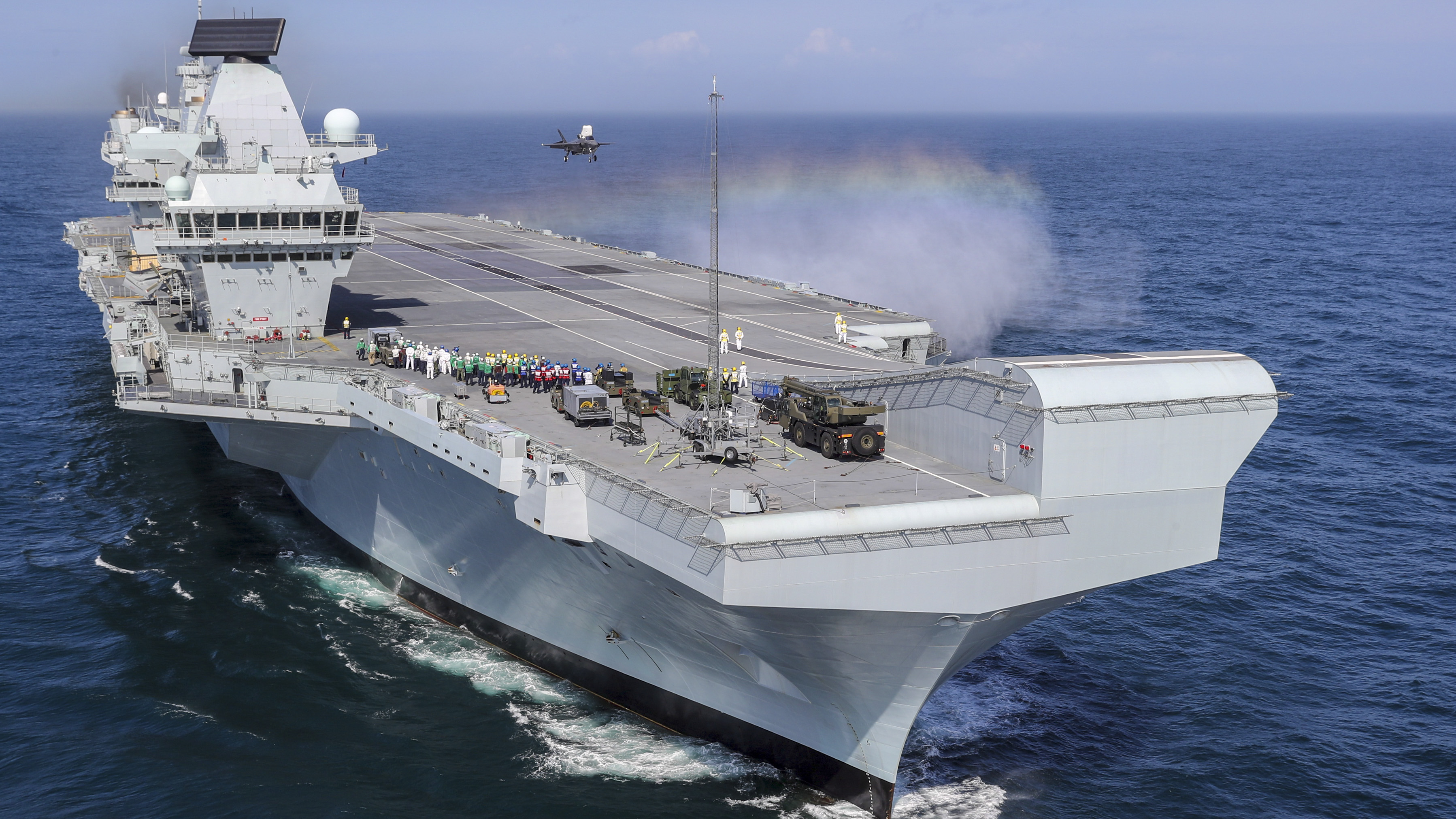 n this handout image provided by the Ministry of Defence, Royal Navy Commander, Nathan Gray lands his F-35B onboard HMS Queen Elizabeth on September 26, 2018 in Portsmouth, England. Two F-35B Lightning II fighter jets have successfully landed onboard HMS Queen Elizabeth for the first time, laying the foundations for the next 50 years of fixed wing aviation in support of the UKs Carrier Strike Capability. (LPhot Kyle Heller/Ministry of Defence via Getty Images)