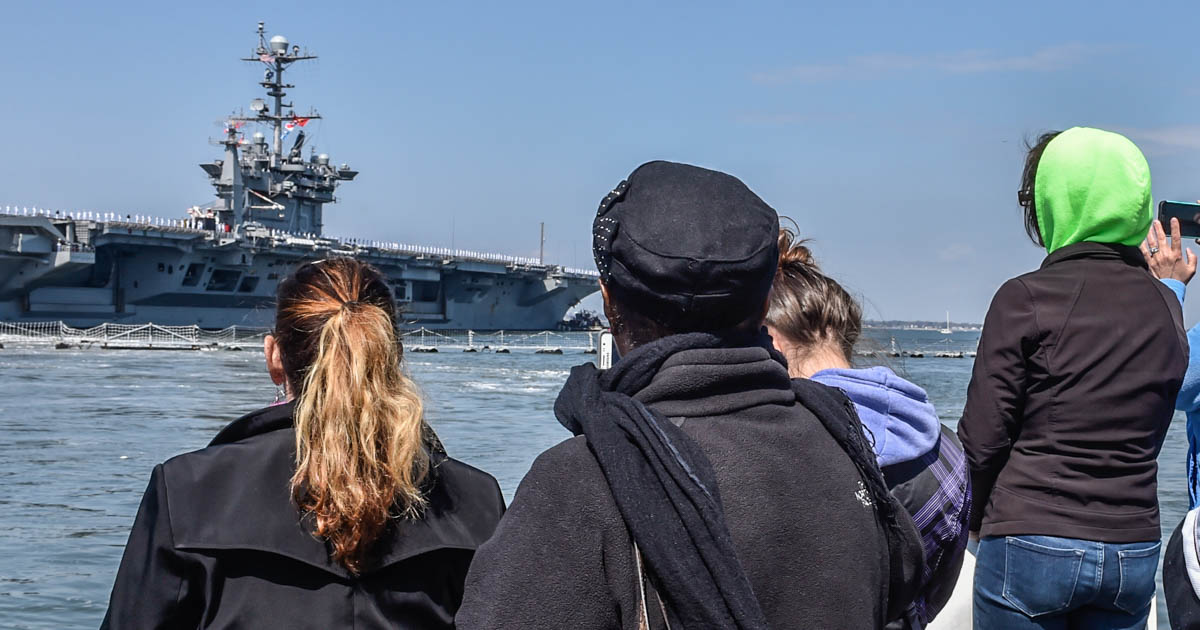 Norfolk, Va. (April 11, 2018) Families watch as the carrier Harry S. Truman departs Norfolk Naval Station on deployment. (photo by Harold J. Gerwien)