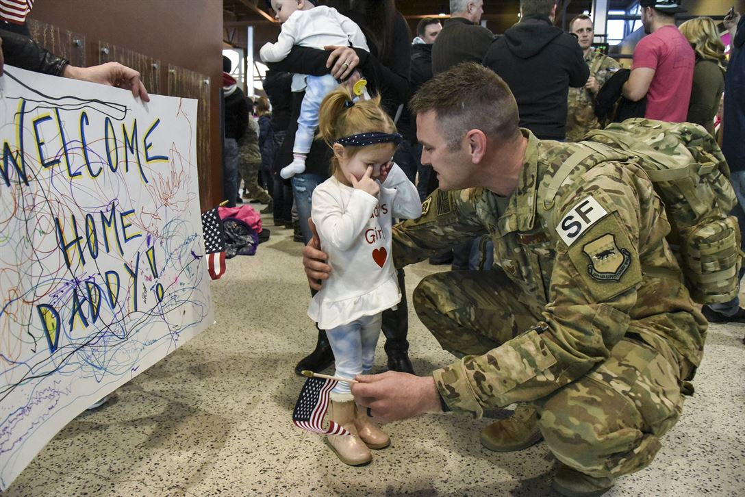 Air Force Staff Sgt. Lucas Nelson prepares to hug his daughter as he returns home to Hector International Airport in Fargo, N.D., Feb. 1, 2018, after a six-month deployment to southwest Asia. Air National Guard photo by Senior Master Sgt. David H. Lipp