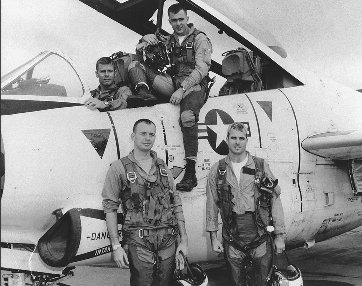 John McCain, front right, poses with his squadron in 1965. McCain has been awarded the Silver Star, Bronze Star, Legion of Merit, Purple Heart, Distinguished Flying Cross medal and the Prisoner of War medal. (Library of Congress via AP)