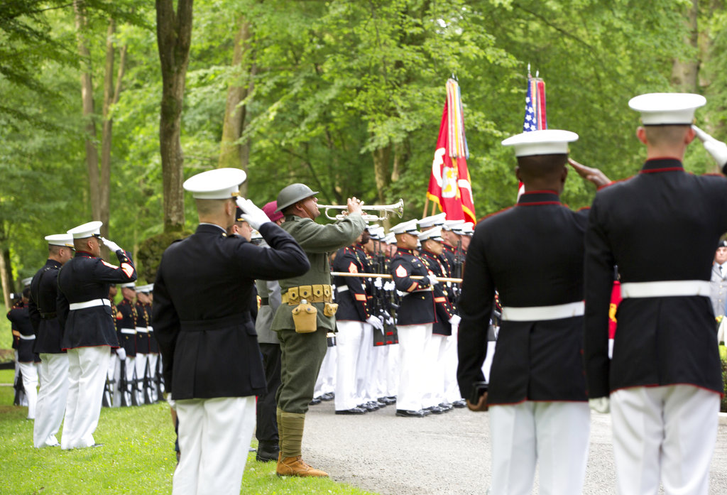 U.S. Marines salute as they participate in a commemoration at the American Marine Memorial in Belleau Wood prior to a service at the Aisne-Marne American Cemetery in Belleau, France, Sunday, May 27, 2018. (Virginia Mayo/AP)