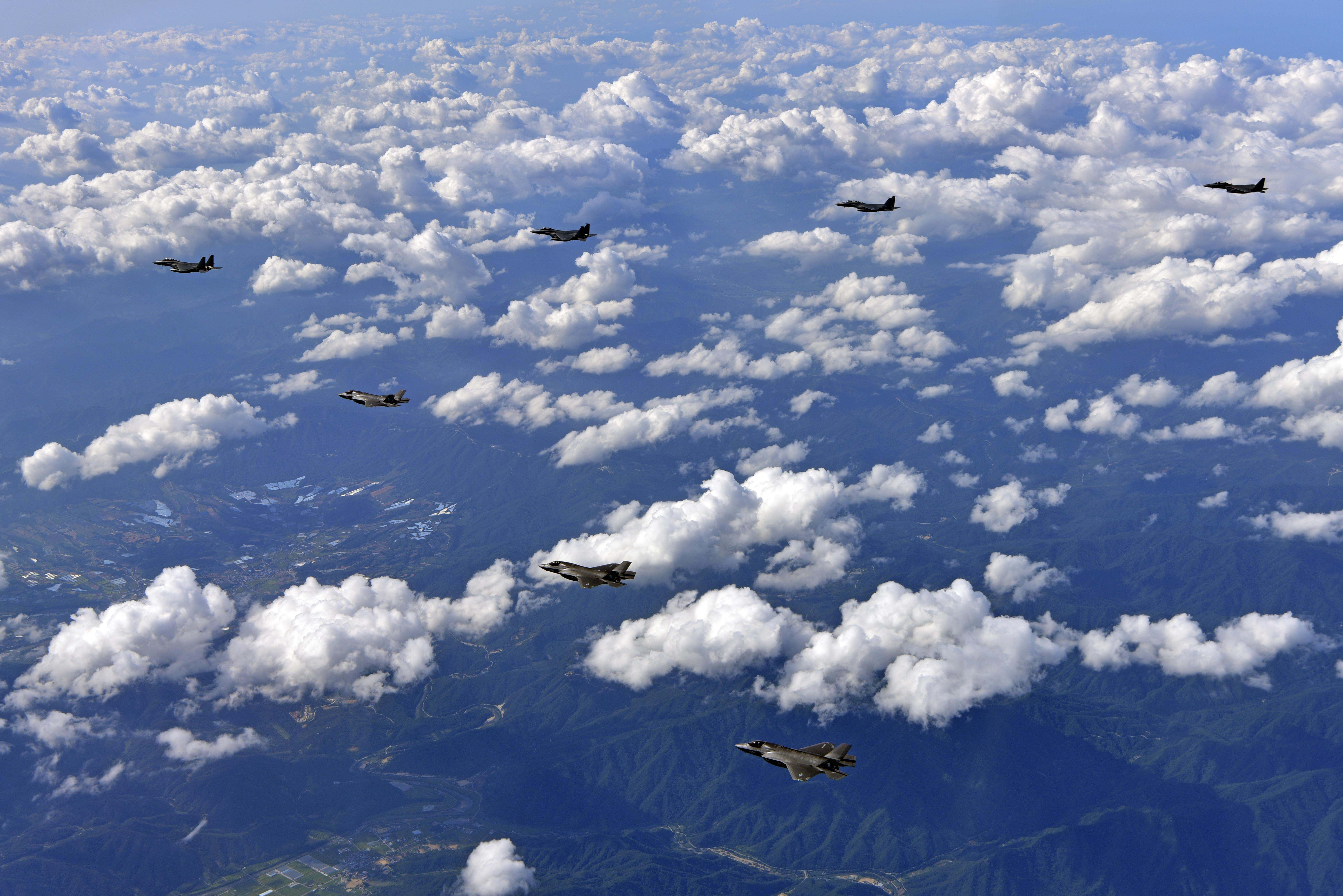 U.S. Marine Corps' F-35B Lightning II fighters assigned to the Marine Corps Air Station Iwakuni, Japan are joined by South Korean Air Force F-15K fighters during a 10-hour mission from Andersen Air Force Base, Guam, into Japanese airspace and over the Korean Peninsula on Aug. 30, 2017. (South Korea Defense Ministry via AP)