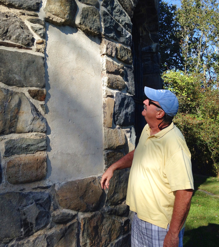 In this Friday, Sept. 29, 201 photo, Bob Cornett, of Newport, R.I., views a World War I memorial, which was vandalized about 40 years ago, while touring Miantonomi Memorial Park Tower with Jack Monahan, (not pictured), a member of the U.S. World War I Centennial Commission, in Newport, R.I. The tower once featured bronze plaques with the names of WWI soldiers from the area who perished. The centennial of America's involvement in World War I has drawn attention to the state of disrepair of many monuments honoring soldiers, galvanizing efforts to fix them. (Jennifer McDermot/AP)
