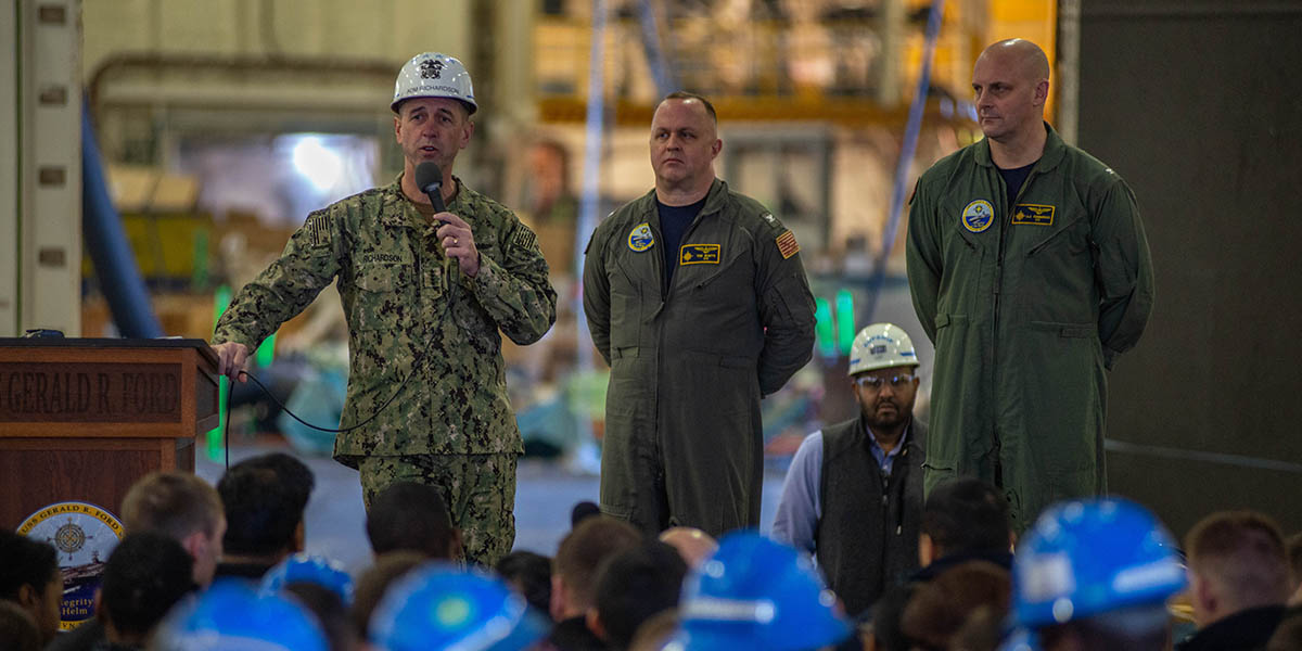 Chief of Naval Operations, Adm. John Richardson talks to the crew of the aircraft carrier Gerald R. Ford as the commanding officer Capt. John J. Cummings (r) and XO Capt. Capt. Tim Waits. (Mark D. Faram/Staff)