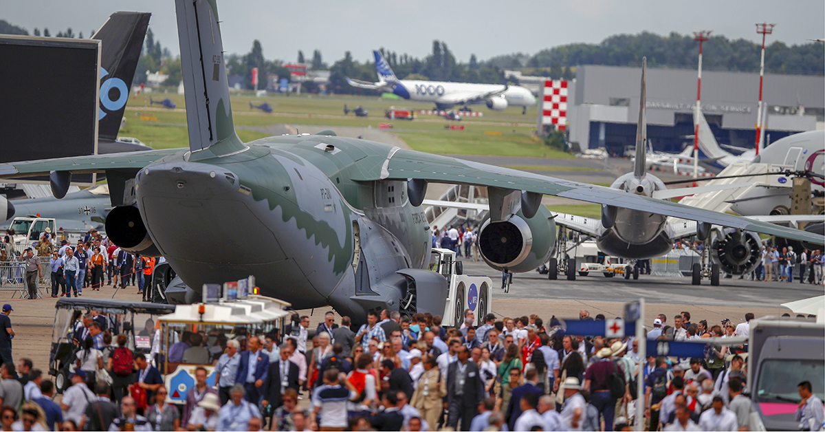 Visitors walk around at the Paris Air Show in Le Bourget, northeast of Paris, France, on June 18, 2019. The world's aviation elite gathered at the event as safety concerns lingered after two crashes of the Boeing 737 Max. (Francois Mori/AP)