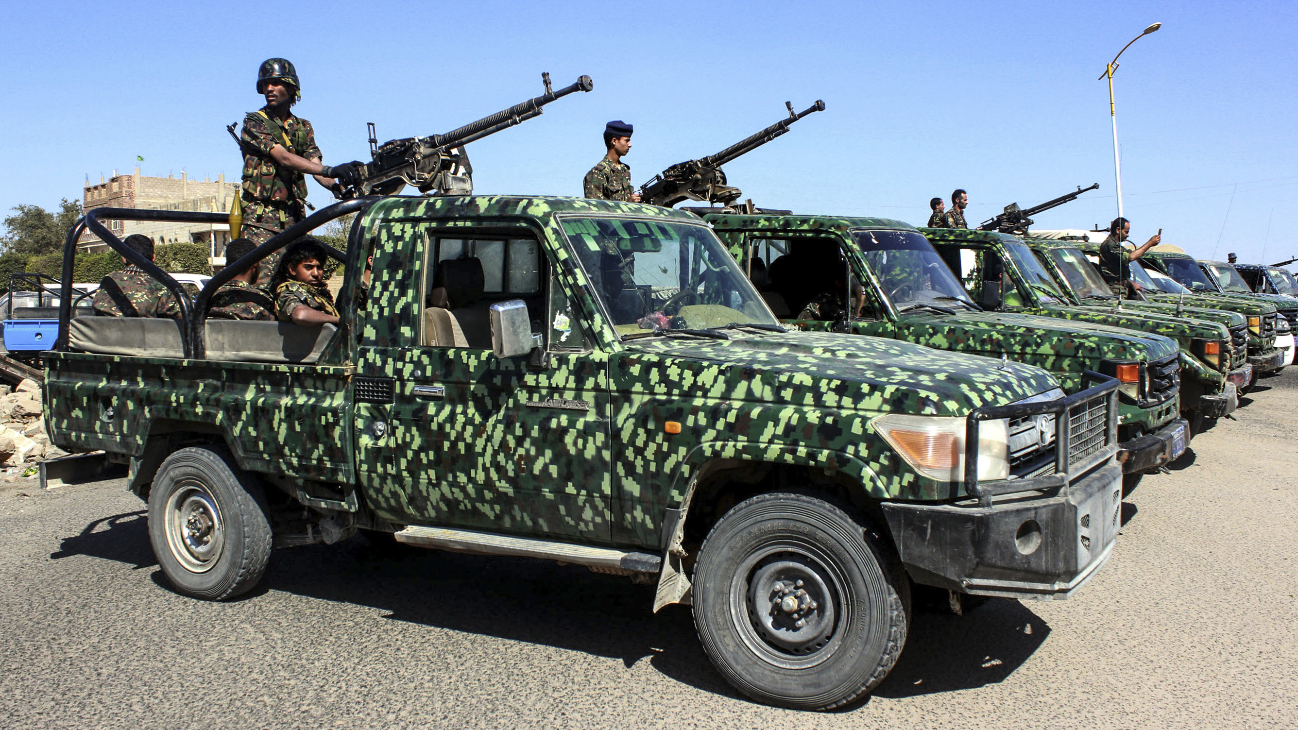 Yemeni soldiers man turrets in pickup trucks lining-up during a graduation ceremony for a new batch of cadets in the northwestern city of Saada on March 2, 2019, in a show of support against the Saudi-led intervention in the country. (AFP/Getty Images)