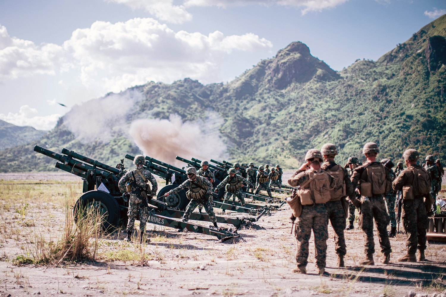 U.S. Marines observe Philippine Marines fire M102 105 mm howitzers during exercise KAMANDAG 3 at Colonel Ernesto Ravina Air Base, Philippines, Oct. 15, 2019. (Staff Sgt. Donald Holbert/Marine Corps)