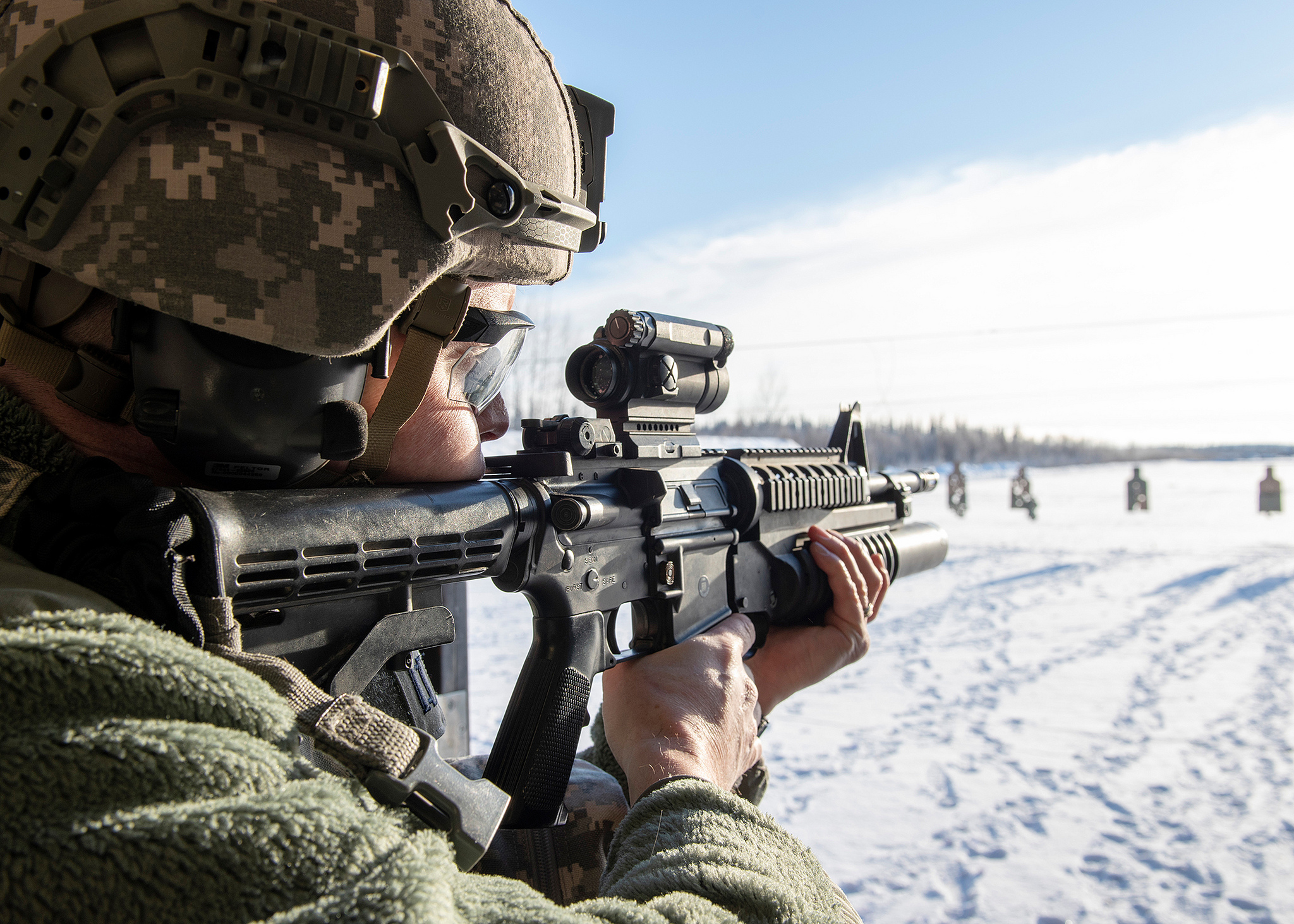 Capt. Andrew Riffe takes aim down range Feb. 9, 2019, at the weapons firing range on Eielson Air Force Base, Alaska. (Airman 1st Class Shannon Chace/Indo-Pacific Command)