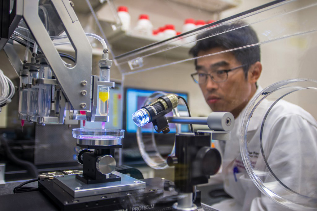 A research fellow works on a project to print experimental muscle tissue for reconstructive surgery. (JBLM PAO)