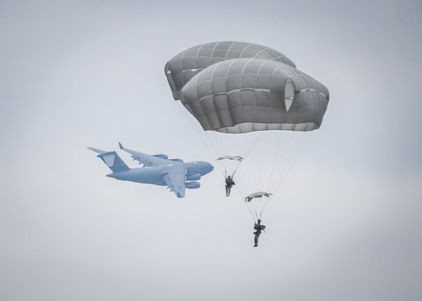 Army paratroopers and eight partner NATO nations conduct airborne operations at Sicily Drop Zone during the 20th Annual Randy Oler Memorial Operation Toy Drop, Dec. 2, 2017. Operation Toy Drop, hosted by the U.S. Army Civil Affairs & Psychological Operations Command (Airborne) and is the largest combined airborne operation conducted worldwide. (Staff Sgt. Timothy R. Koster/Army)