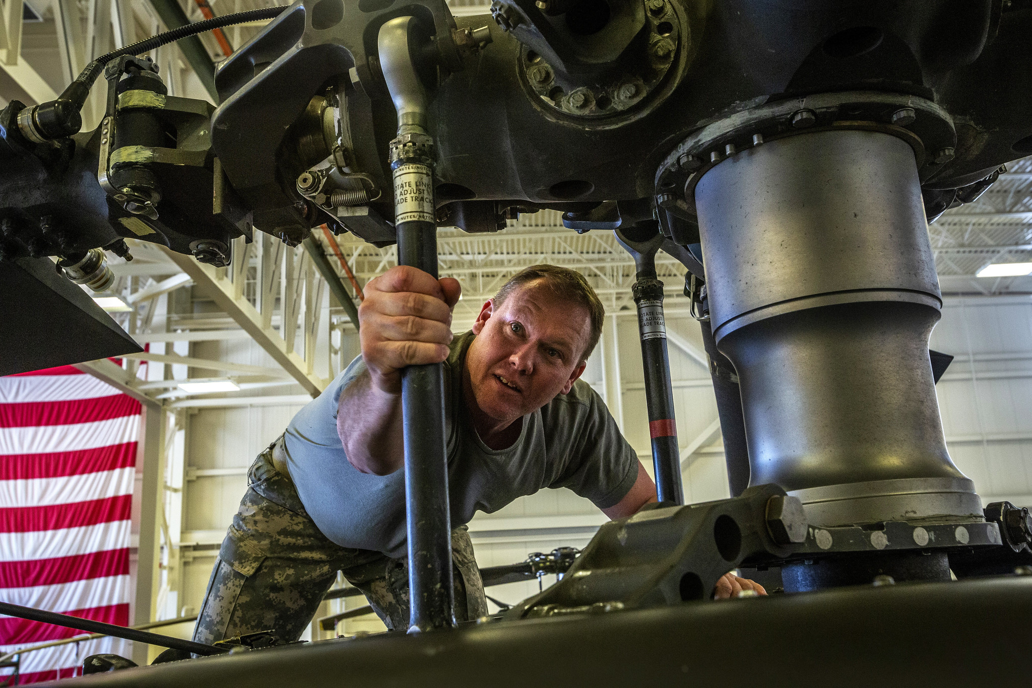 Chief Warrant Officer 3 Charles E. Fisher, a UH-60L Black Hawk helicopter pilot with the New Jersey Army National Guard, performs a final check April 17, 2019, during maintenance at the Army Aviation Support Facility at Joint Base McGuire-Dix-Lakehurst, N.J. (Mark C. Olsen/Army National Guard )