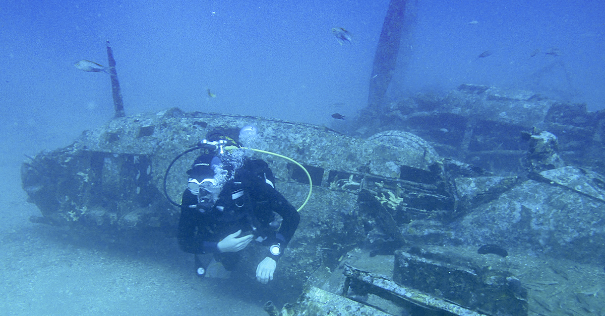 A diver explores the wreckage of an American fighter plane from the Second World War, the Lockheed P-38G Lightning, at 38 meters of depth, on August 12, 2018, off the coast of La Ciotat, southern France. The plane was shot down by the German Air Force on January 27, 1944 and the pilot Harry R. Greenup was taken prisoner. (BORIS HORVAT/AFP/Getty Images)
