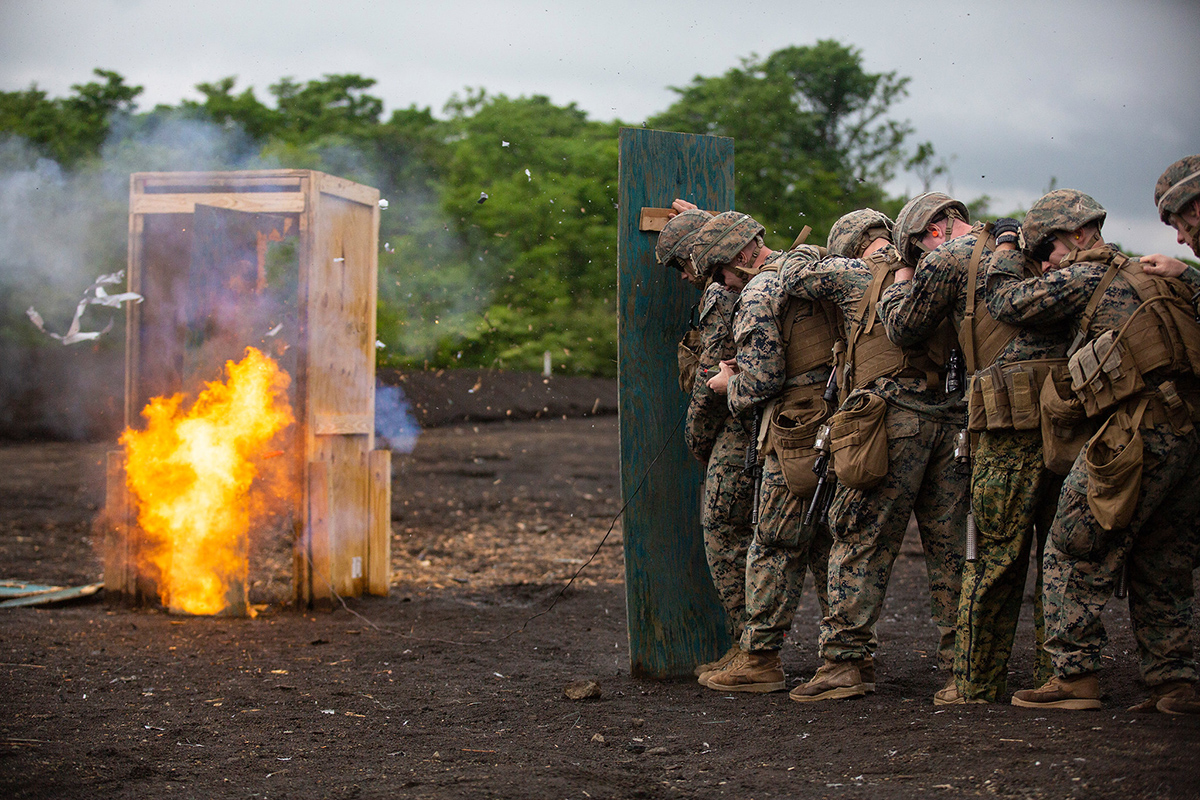 Marines stand behind a wooden shield during an urban-breaching range on Exercise Fuji Viper, at Combined Arms Training Center, Camp Fuji, June 11, 2019. (Lance Cpl. Joshua Sechser/Marine Corps)