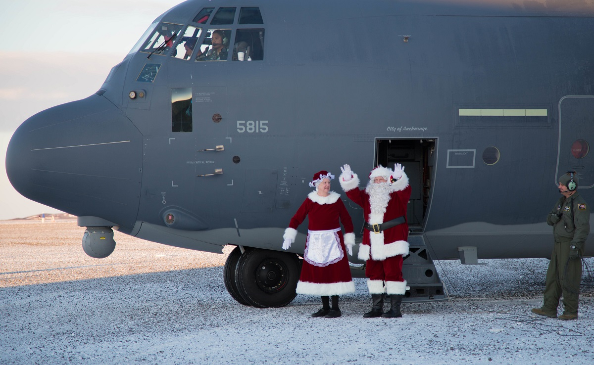 Mr. and Mrs. Santa Claus, travelling with Operation Santa Claus, de-board an HC-130J Combat King II from the 211th Rescue Squadron, Alaska Air National Guard, after landing in St. Michael, Alaska, on Dec. 5, 2017. Operation Santa Claus is an Alaska National Guard annual community outreach program that provides Christmas gifts, books, backpacks filled with school supplies, fresh fruit and sundaes to youngsters in rural communities. (2nd Lt. Marisa Lindsay/Army National Guard)