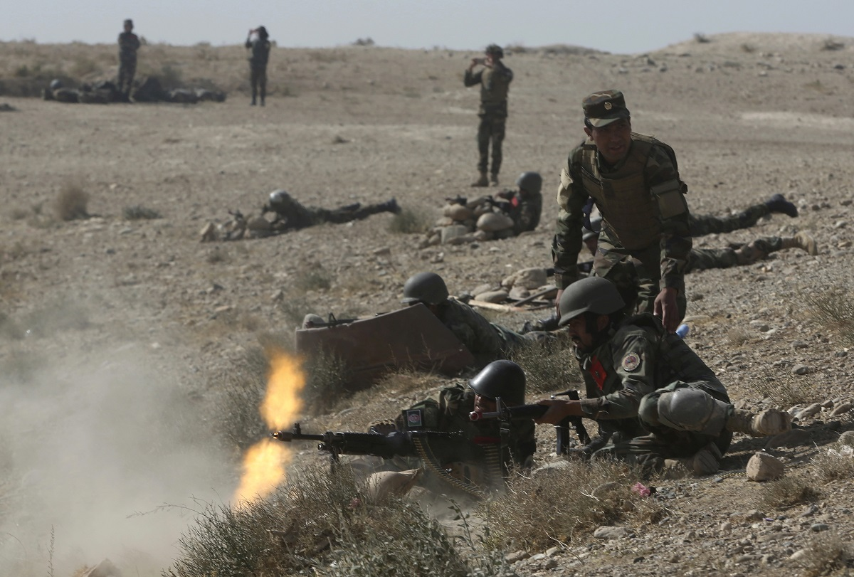 Afghan National Amy commandos open fire during a military exercise in Kabul, Afghanistan, Tuesday.. (Massoud Hossaini/AP)
