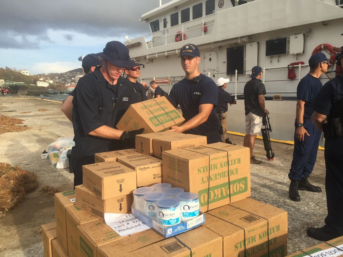 Coast Guard Cutter Joseph Tezanos crewmembers load a pallet of emergency ration meals for emergency responders to pass out to the residence of St. Thomas, U.S. Virgin Island, Sept. 10, 2017, after Hurricane Irma severely damaged the island. (Chief Petty Officer Crystalynn Kneen/Coast Guard)