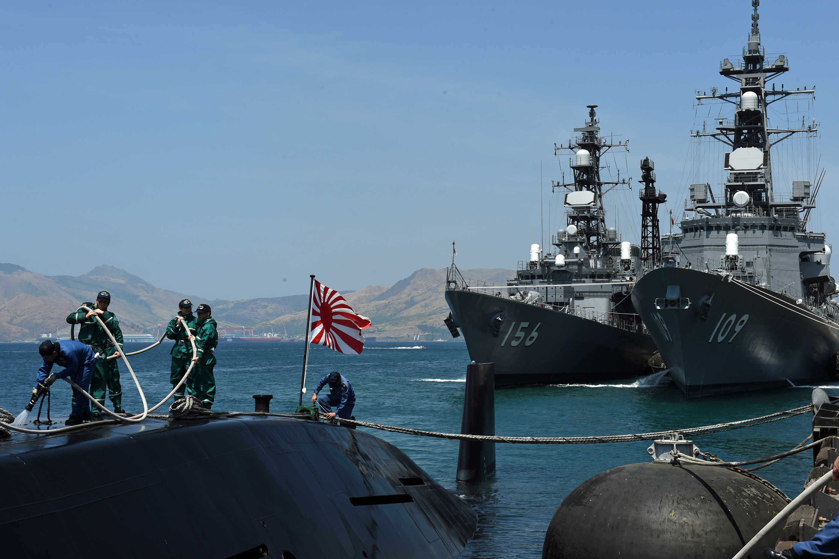 Two Japanese destroyers and a submarine dock at a Philippine port April 3, 2016, near disputed South China Sea waters, where Beijing's increasingly assertive behavior has sparked global concern. (TED ALJIBE/AFP/Getty Images)