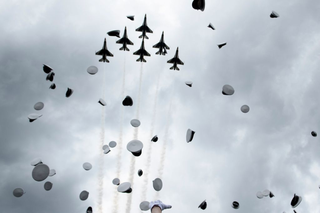 Graduates celebrate and throw up their caps as the Air Force Thunderbirds fly overhead during the 2019 graduation ceremony at the United States Air Force Academy May 30, 2019, in Colorado Springs, Colorado. (BRENDAN SMIALOWSKI/AFP/Getty Images)